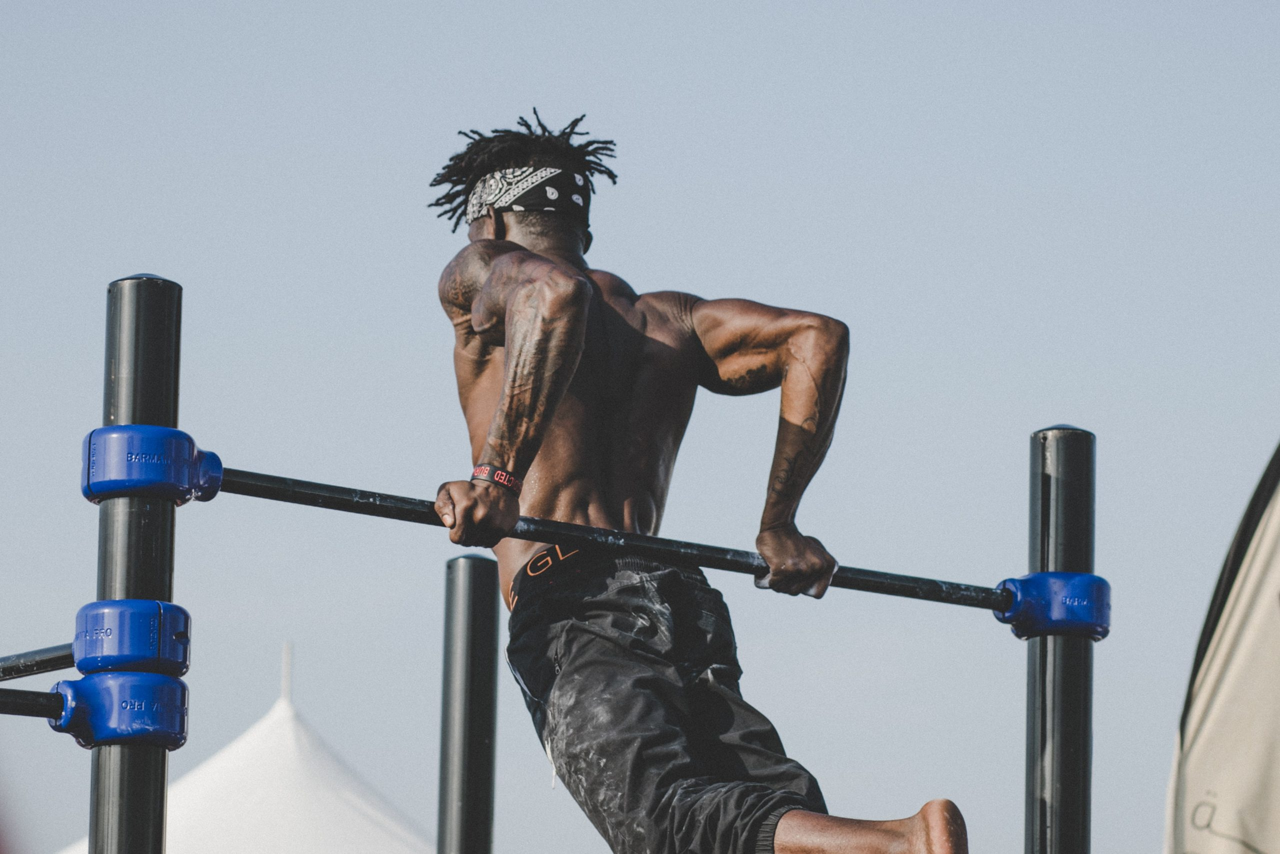 man in pull up bar